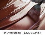 closeup of a worker spreading... | Shutterstock . vector #1227962464