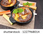 pie klafouti with rhubarb in... | Shutterstock . vector #1227968014