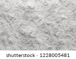 white natural wool with twists... | Shutterstock . vector #1228005481