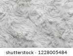 white natural wool with twists... | Shutterstock . vector #1228005484