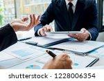 business team meeting present.... | Shutterstock . vector #1228006354
