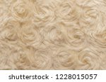 beige natural wool with twists... | Shutterstock . vector #1228015057