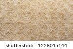 beige natural wool with twists... | Shutterstock . vector #1228015144