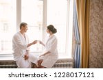 man and woman in white coats at ... | Shutterstock . vector #1228017121