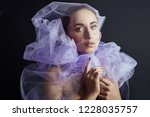 woman wrapped in purple fabric  ... | Shutterstock . vector #1228035757