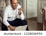 businessman talking on phone... | Shutterstock . vector #1228036954