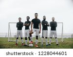 five football players standing... | Shutterstock . vector #1228044601