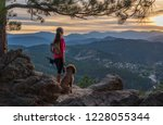 a hispanic woman is hiking with ... | Shutterstock . vector #1228055344