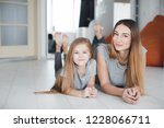 young mother with daughter... | Shutterstock . vector #1228066711