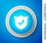 white shield with check mark... | Shutterstock . vector #1228070311