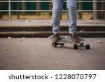 closeup of a men's feet on a... | Shutterstock . vector #1228070797