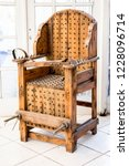 old wooden chair with spikes... | Shutterstock . vector #1228096714