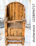 old wooden chair with spikes... | Shutterstock . vector #1228096717