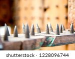 old wooden chair with spikes... | Shutterstock . vector #1228096744