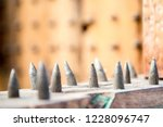 old wooden chair with spikes... | Shutterstock . vector #1228096747