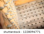 old wooden chair with spikes... | Shutterstock . vector #1228096771