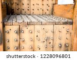 old wooden chair with spikes... | Shutterstock . vector #1228096801