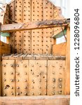 old wooden chair with spikes... | Shutterstock . vector #1228096804