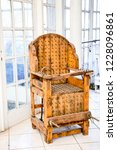 old wooden chair with spikes... | Shutterstock . vector #1228096861