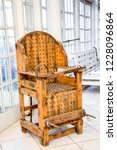 old wooden chair with spikes... | Shutterstock . vector #1228096864