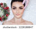 a beautiful woman gets a facial ... | Shutterstock . vector #1228188847