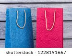 two colorful shopping bags from ... | Shutterstock . vector #1228191667