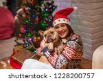 close up of young woman hugging ... | Shutterstock . vector #1228200757
