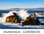 Surf Breaks On Rocks At Point...