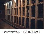 bottles of wine in the wine...   Shutterstock . vector #1228214251