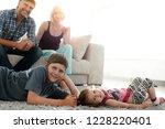 portrait of children while... | Shutterstock . vector #1228220401