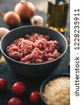 minced pork meat in bowl  next... | Shutterstock . vector #1228235911