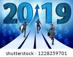 businessman running into year... | Shutterstock . vector #1228259701