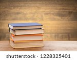 stack of books on table at... | Shutterstock . vector #1228325401