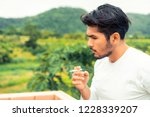 young man smoking cigarette in...   Shutterstock . vector #1228339207
