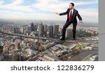 business man balancing high... | Shutterstock . vector #122836279