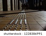 tactile paving to assist the... | Shutterstock . vector #1228386991