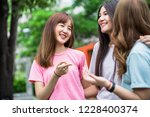 group of students sharing with... | Shutterstock . vector #1228400374