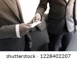 business executive exchanging... | Shutterstock . vector #1228402207