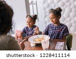 cafeteria with mother. two cute ... | Shutterstock . vector #1228411114