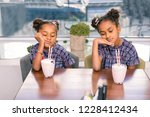 bored siblings. two cute funny... | Shutterstock . vector #1228412434