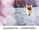 glasses of champagne on the... | Shutterstock . vector #1228423894