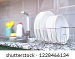 clean plates in dish drying... | Shutterstock . vector #1228466134