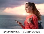 a young  happy girl traveler... | Shutterstock . vector #1228470421