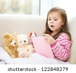 little girl is reading a story
