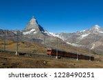 a train on the gornergrat bahn... | Shutterstock . vector #1228490251