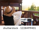 young woman traveler sits at... | Shutterstock . vector #1228499401