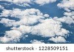 clouds in dark blue sky... | Shutterstock . vector #1228509151