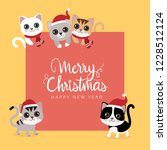 Stock vector merry christmas and happy new year greeting card with cute cat wear santa claus hat animal 1228512124
