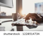 men typing on computer keyboard.... | Shutterstock . vector #1228514734