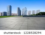 empty square with city skyline | Shutterstock . vector #1228528294